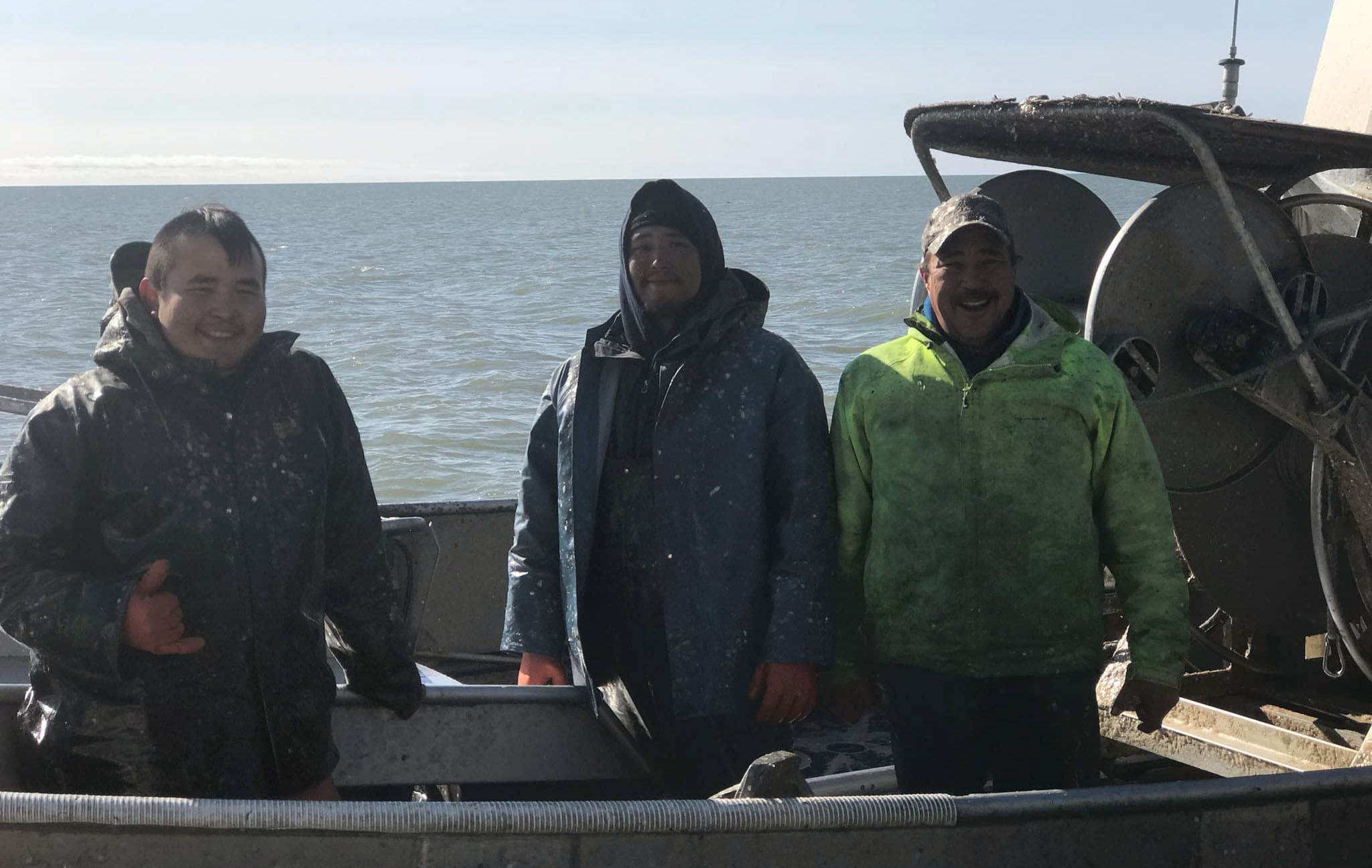 Woods, right, and his crewmates take a break from fishing the Bering Sea. Photo courtesy of Frank Woods.